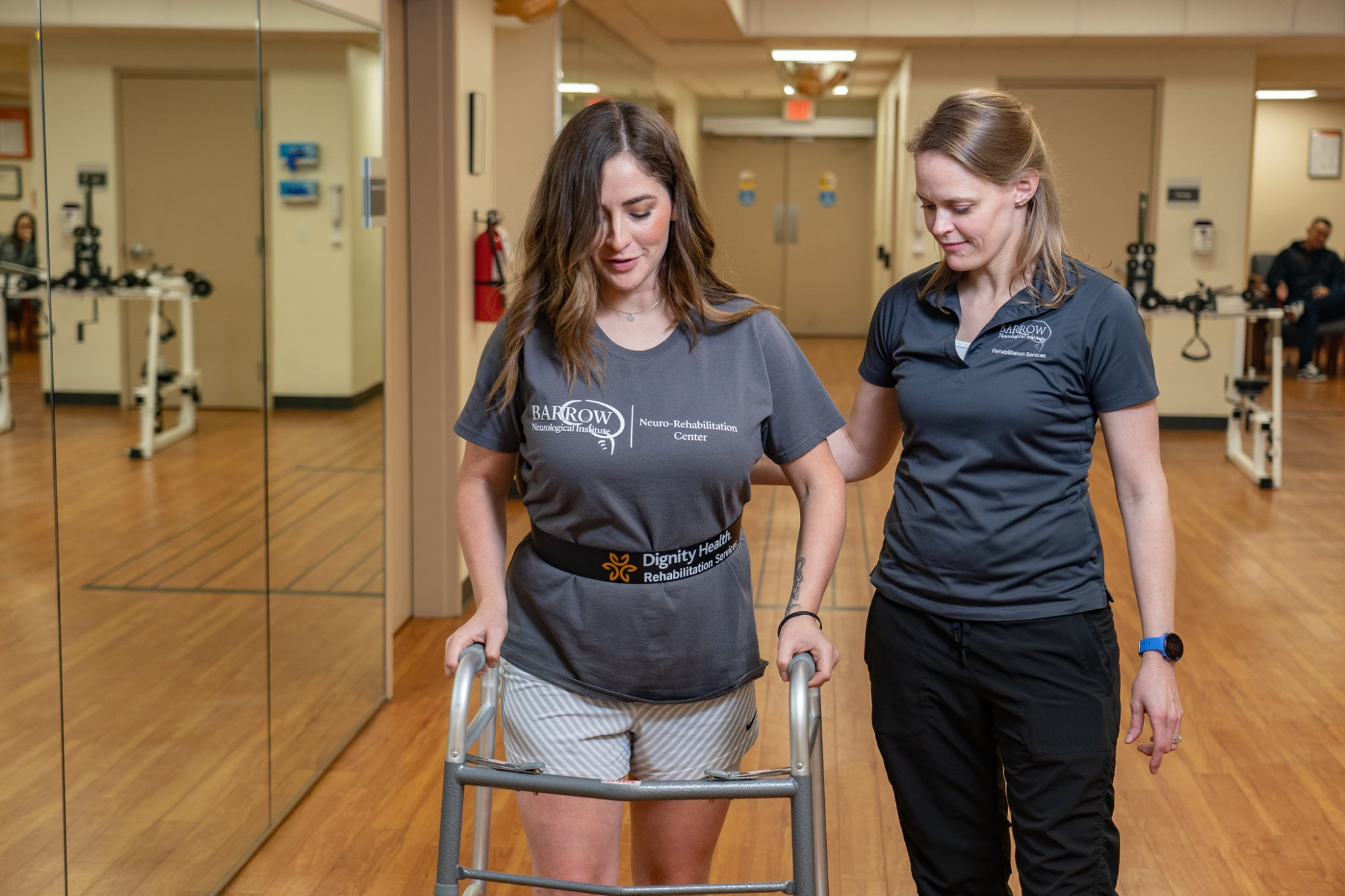 Therapist assisting patient to walk at the Neuro-Rehabilitation Center at Barrow.