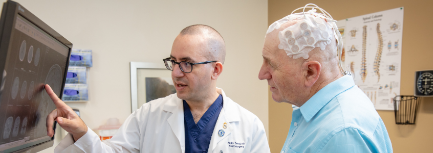 Dr. Sanai reviewing MRI results with brain cancer patient